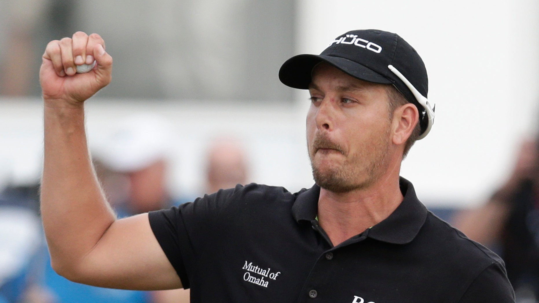 FILE - In this Nov. 17, 2013, file photo, Henrik Stenson from Sweden celebrates after winning the DP World Golf Championship, in Dubai, United Arab Emirates. Stenson is now in South Africa to play in the Nedbank Golf Challenge starting Thursday, Dec. 5, 2013. (AP Photo/Hassan Ammar, File)