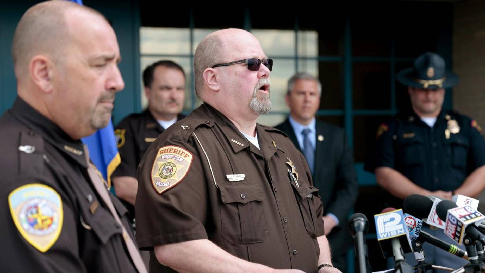 Columbia County Sheriff Dennis Richards updating reporters on the suspected gunman.