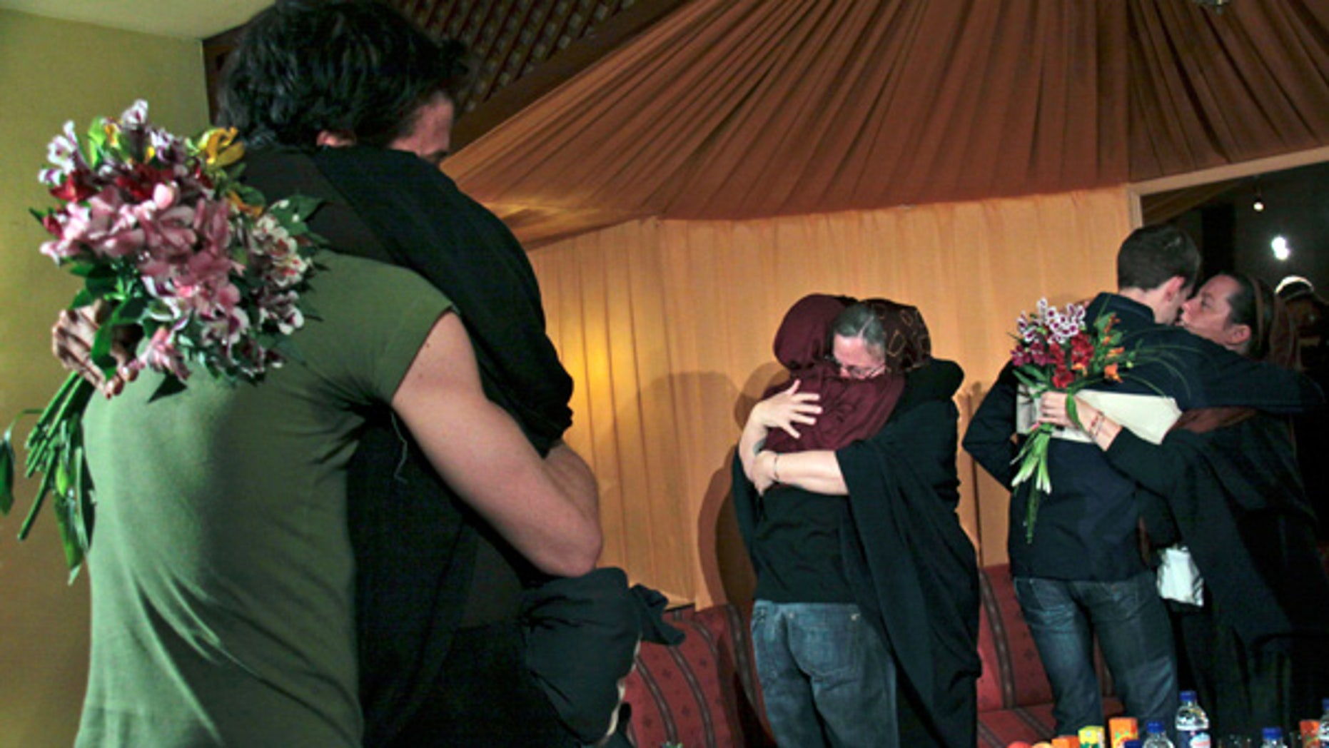 May 20: The mothers of 3 Americans detained in Iran hug their children at the Esteghlal hotel in Tehran.
