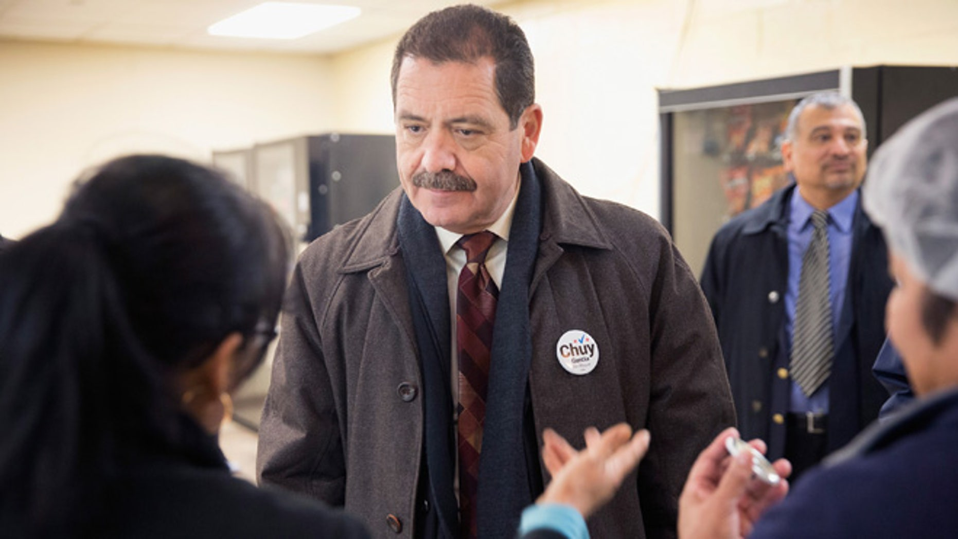 """CHICAGO, IL - FEBRUARY 23:  Chicago Mayoral candidate Jesus """"Chuy"""" Garcia greets workers during a campaign stop at a linen and uniform service company on February 23, 2015 in Chicago, Illinois. Recent polls show Garcia is running second to incumbent Mayor Rahm Emanuel whose lead is not currently large enough to avoid a runoff election. Chicago residents go to the polls Tuesday, February 24.  (Photo by Scott Olson/Getty Images)"""