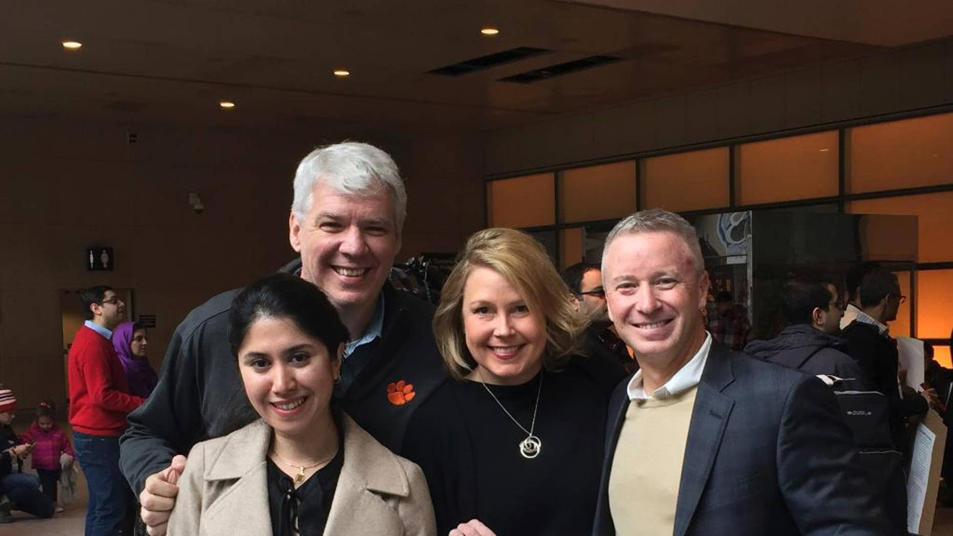 In this photo provided by Eric Martinez, Nazanin Zinouri, front left, and her colleagues from Modjoul, a startup technology firm in Clemson, S.C., pose for a photo after Zinouri arrived at Logan International Airport in Boston on Sunday, Feb. 5, 2017. Zinouri, an Iranian engineer who had been blocked from returning to South Carolina by President Donald Trump's travel ban against seven Muslim nations, returned to the U.S. on Sunday. Modjoul founder Martinez, from left, co-worker Jen Thorson and Rick Toller stand by Zinouri. (courtesy of Eric Martinez via AP)