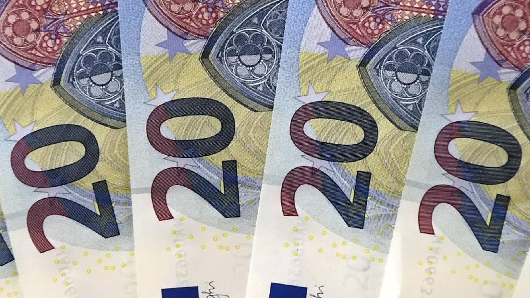 FILE - In this Tuesday, Oct. 27, 2015, file photo, new 20 euro banknotes are arranged for display during a news conference at the branch office of the German Federal Bank in Erfurt, Germany. No one is lining up to join the 19-country currency, and the next memberships, if any, will only be years down the road, certainly not in this decade. It marks a shift from a recent boom in membership, with seven countries joining in the past nine years, and reflects in part a growing wariness of forging closer economic ties. (AP Photo/Jens Meyer, File)
