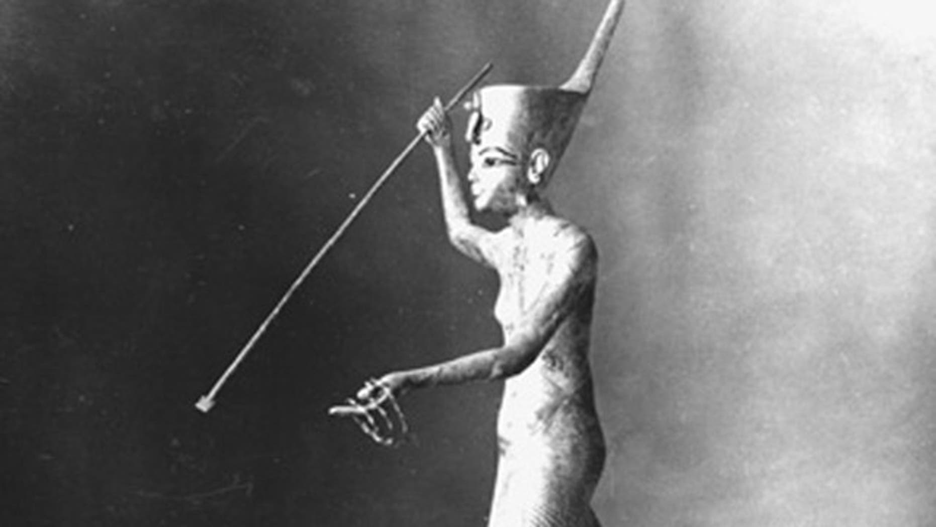 This undated photo released by the Egyptian Ministry of Antiquities shows a gilded wooden statue of King Tutankhamun harpooning. According to the Ministry of Antiquities, a full inventory of the Egyptian Museum has found that looters escaped with 18 items, including this one, during the anti-government unrest.