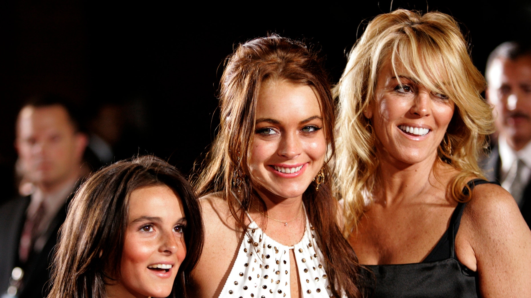"""Lindsay Lohan poses with her mother Dina and sister Aliana at premiere of """"Just My Luck"""" in Los Angeles."""