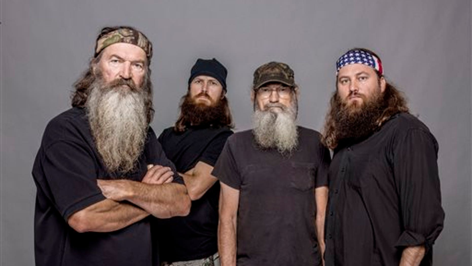 """This 2012 photo released by A&E shows, from left, Phil Robertson, Jase Robertson, Si Robertson and Willie Robertson from the A&E series, """"Duck Dynasty,"""" airing Wednesdays at 10 p.m. EST."""