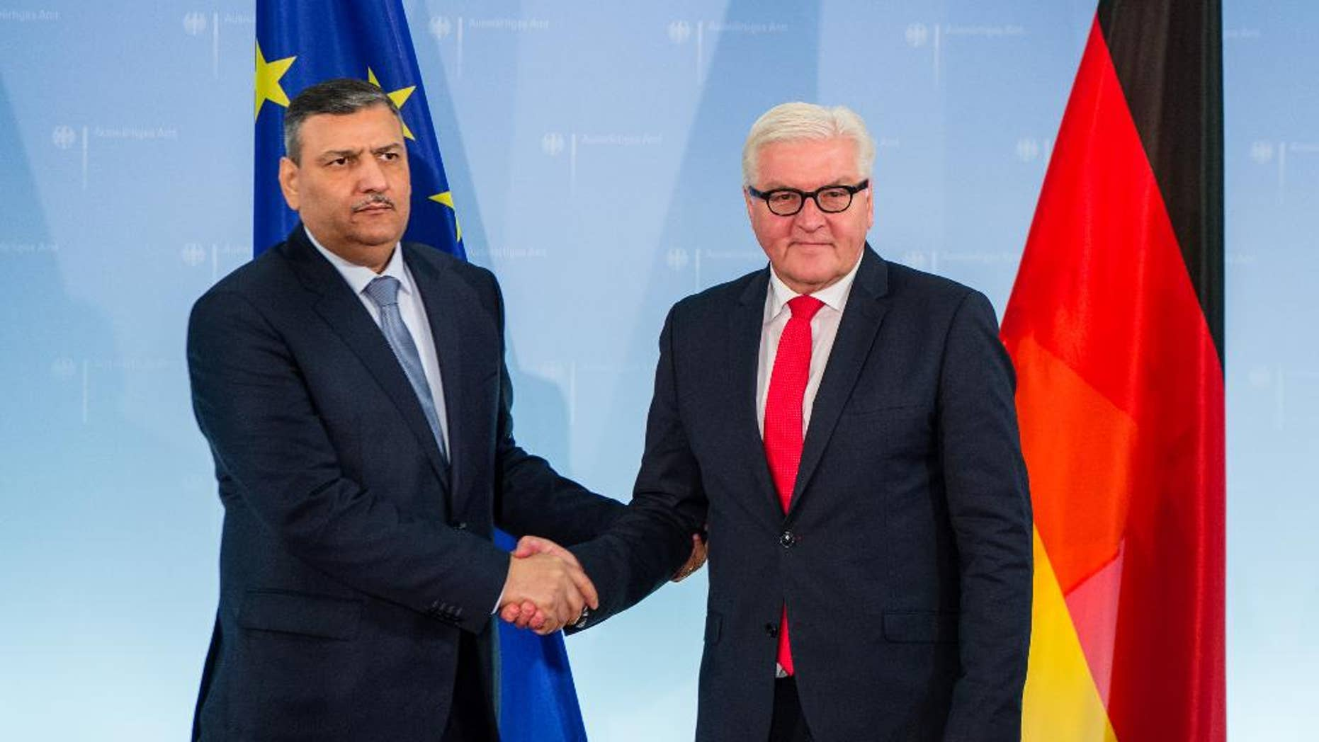 Former Syrian  Prime Minister Dr Riyad Farid Hijab, now coordinator  of the High Negotiations Committee of the Syrian Opposition (HNC) , left, shakes hands with German foreign minister Frank-Walter Steinmeier during their meeting in Berlin, Thursday Nov. 3, 2016.  (Sebastian Gollnow/dpa via AP)