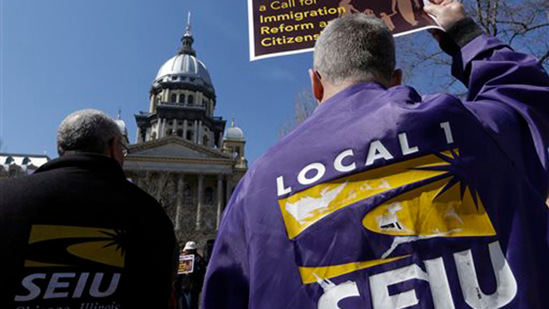 FILE - In this March 20, 2014 file photo, members of the Service Employees International Union, SIEU, rally in front of the Illinois State Capitol in support of Immigration reform in Springfield, Ill. Unions across the U.S. are reaching out to immigrants affected by President Obamaâs recent executive action in hopes of expanding their dwindling ranks by recruiting millions of workers who entered the U.S. illegally. Labor leaders say the action will give new protection to workers whoâve been reluctant to join for fear of retaliation. The action curbs deportation and gives work permits to some 4 million immigrants. (AP Photo/Seth Perlman,File)