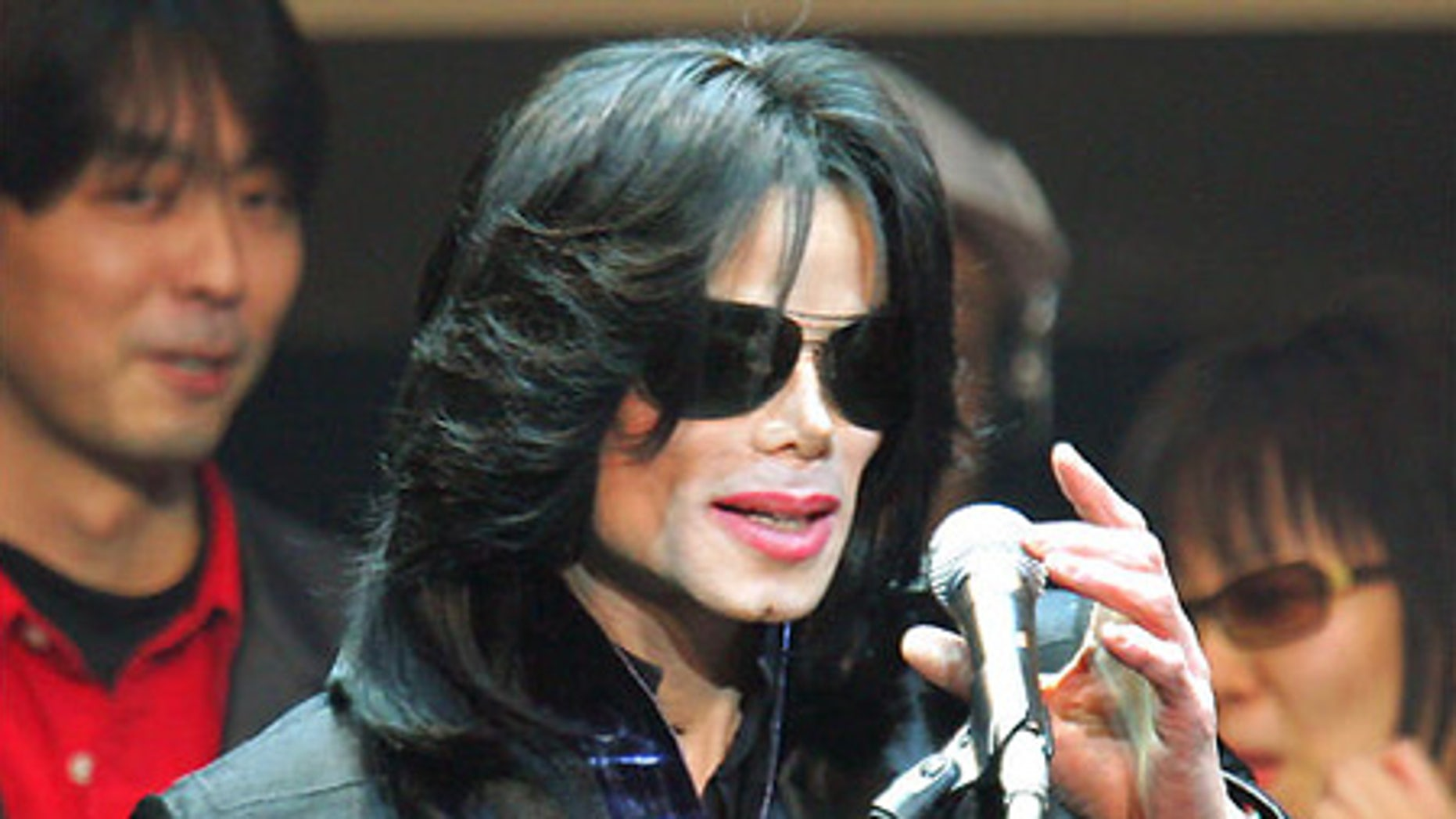 """March 9, 2007: Michael Jackson delivers a speech to fans during an event called """"Fan Appreciation Day"""" in Tokyo."""