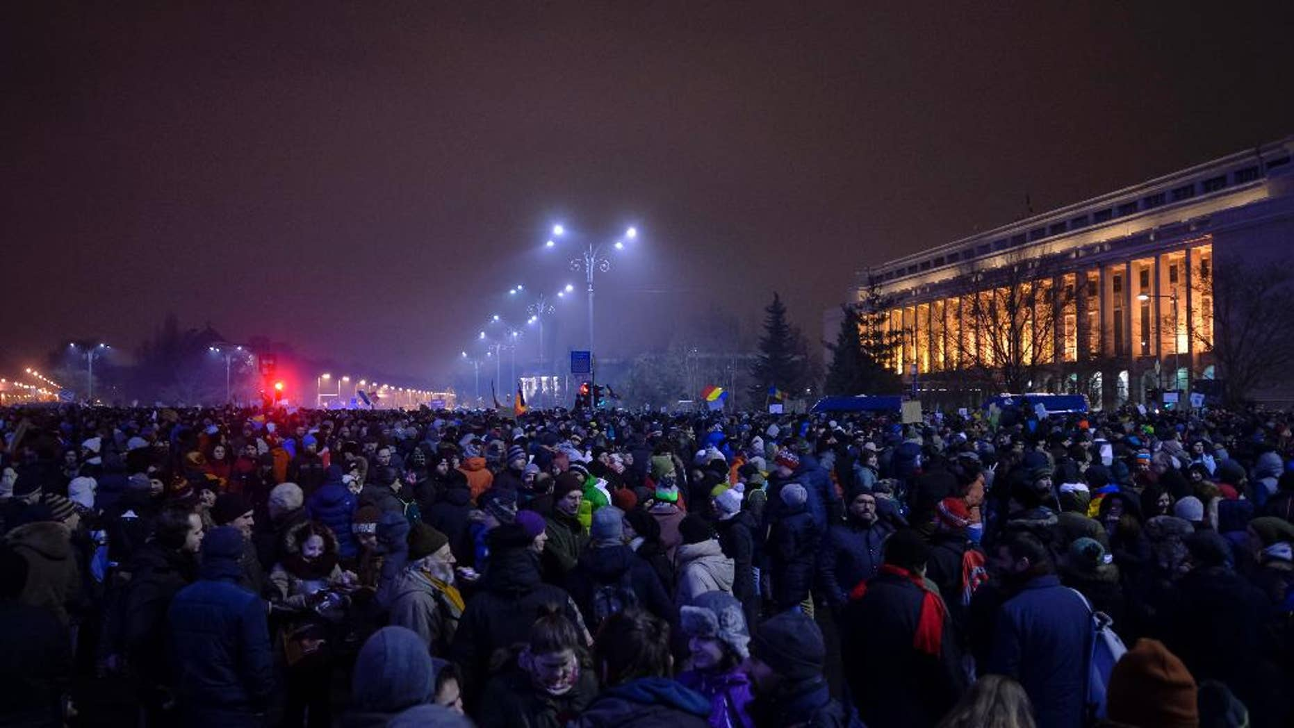 Some thousands march during a protest against the government's proposal to pardon thousands of prisoners, in Bucharest, Romania, Sunday, Jan. 22, 2017.  Some thousands marched through the streets of the Romanian capital and other cities to protest against the pardon of prisoners which critics say could weaken the anti-corruption fight. (AP Photo/Andreea Alexandru)