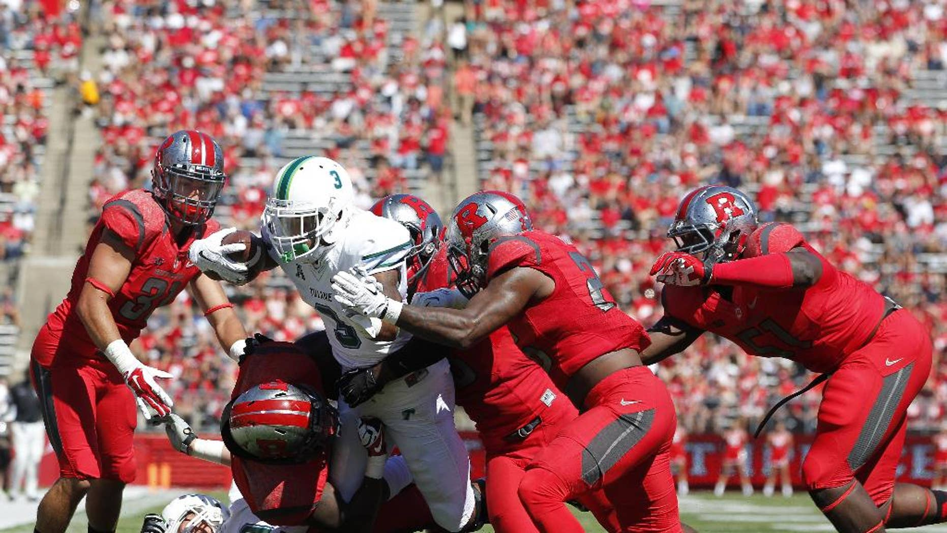 Tulane running back Sherman Badie (3) is tackled by Rutgers defenders L.J. Liston, Jonathan Aiken and others short of the end zone during the first half of an NCAA college football game, Saturday, Sept. 27, 2014, in Piscataway, N.J. Rutgers defeated Tulane 31-6. (AP Photo/Rich Schultz)