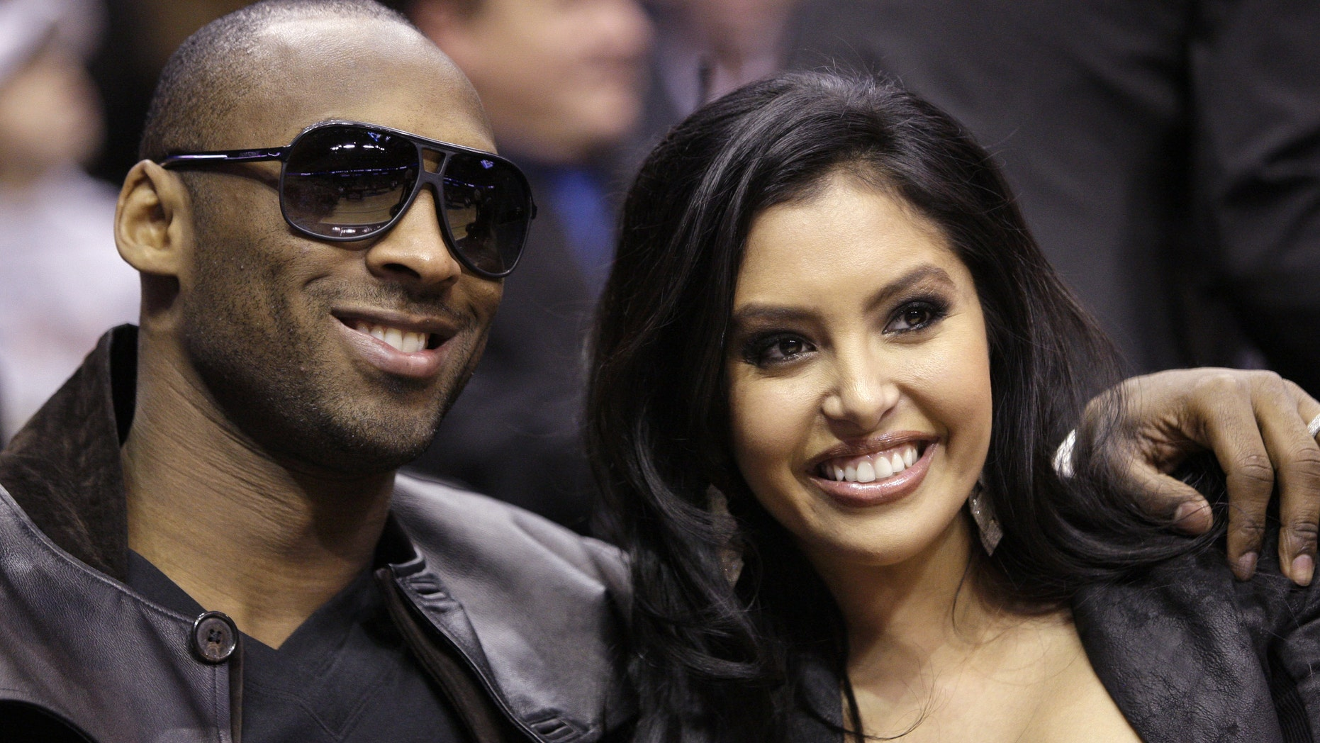 File-This Feb. 13, 2010 file photo shows Los Angeles Lakers' Kobe Bryant and his wife, Vanessa, attending the skills competition at the NBA basketball All-Star Saturday Night in Dallas.  The Los Angeles Lakers superstar and his wife both announced they've called off their divorce Friday Jan. 11, 2013, on social media. Shortly after Vanessa posted the news on Instagram, Kobe confirmed it on Facebook less than an hour before the Lakers hosted the Oklahoma City Thunder. (AP Photo/LM Otero, File)