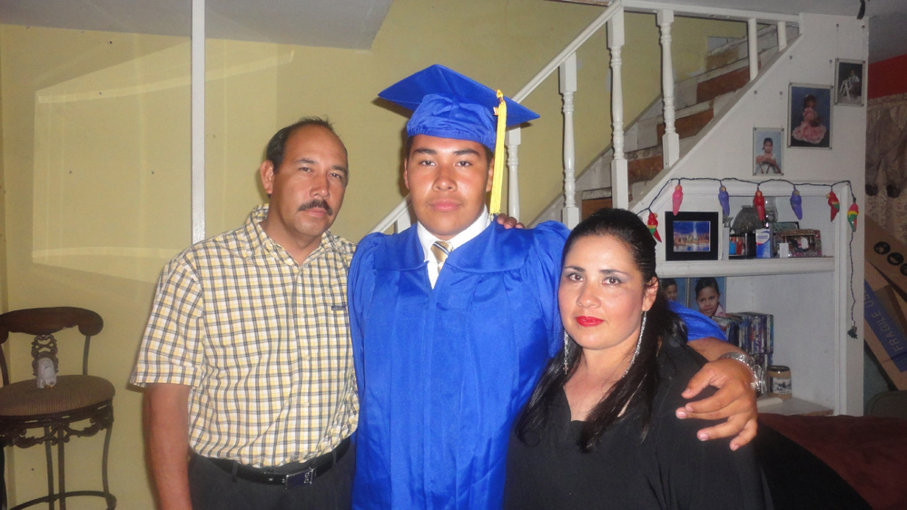 Marcos Muñoz and his parents. Muñoz traveled to Tijuana after his graduation ceremony to celebrate his graduation with the people he loves the most.