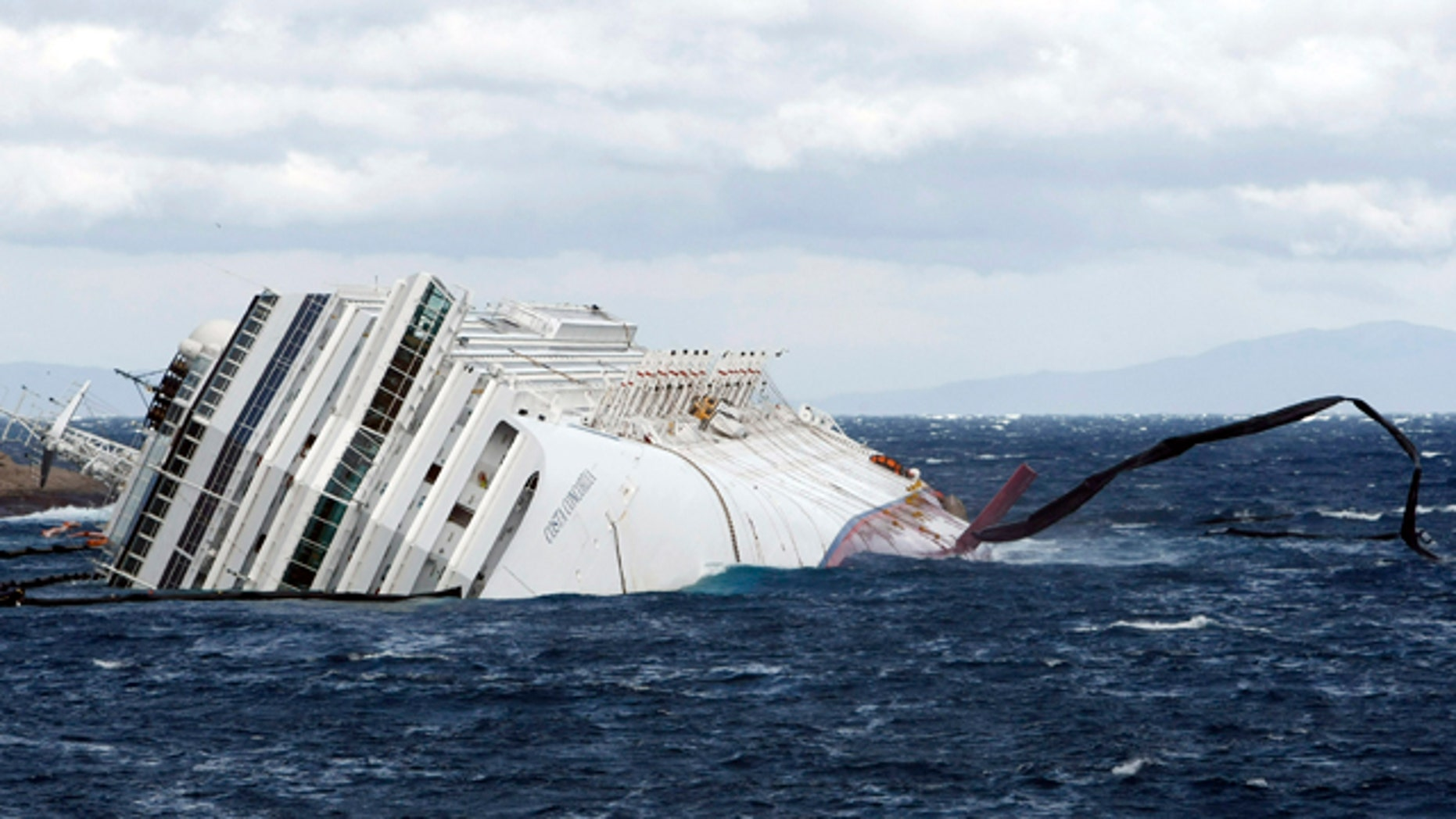 Feb. 1: Anti oil floating barriers are pushed by strong winds around the grounded cruise ship Costa Concordia off the Tuscan island of Giglio, Italy.