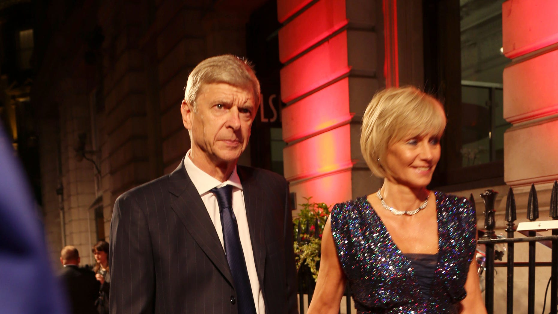The French manager of Britain's Arsenal soccer club, Arsene Wenger and wife Annie, arrive for the British Film Institute (BFI) London Film Festival Gala Dinner in central London, Tuesday, Oct. 8, 2013. The BFI event attracts many top names from the sports and arts field. (Photo by Joel Ryan/Invision/AP)