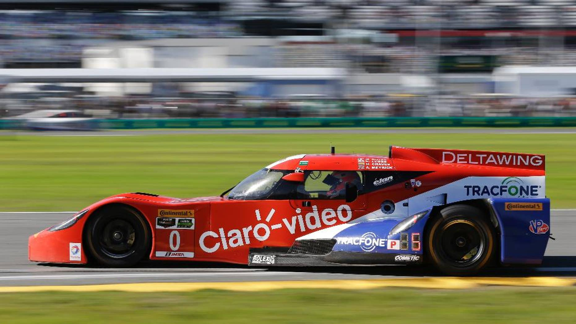 In this Saturday, Jan. 24, 2015 file photo, Andy Meyrick, of England, drives the DeltaWing DWC13 Elan out of turn during the IMSA 24 hour auto race at Daytona International Speedway in Daytona Beach, Fla. Among the story lines in IMSA this year is the strength of the odd-looking DeltaWing, which led laps in the season-opening Rolex 24 at Daytona. (AP Photo/John Raoux, File)