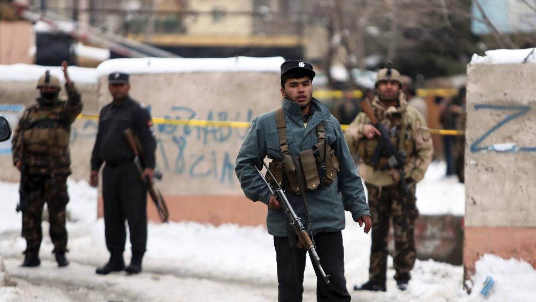 Security personnel stand guard at the site of a suicide attack on the Supreme Court in Kabul, Afghanistan, Tuesday, Feb. 7, 2017. A suicide bomber on Tuesday targeted the Supreme Court building in the Afghan capital, Kabul, killing over a dozen people, officials said. (AP Photo/Rahmat Gul)
