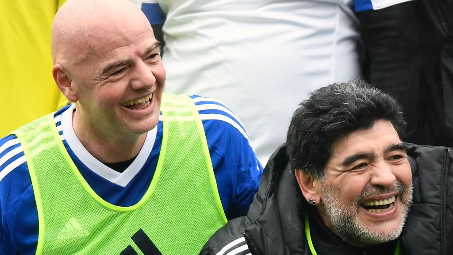 FILE - In this Monday, Jan. 9, 2017 file photo, Argentina's former soccer player Diego Maradona, right, and FIFA President Gianni Infantino share a laugh during a soccer match with FIFA Legends at the home of FIFA in Zurich, Switzerland. FIFA's peacemaking with Diego Maradona has led to an ambassador's role for the Argentina great, announced late Thursday Feb. 9, 2017 by Maradona. (Walter Bieri/Keystone via AP, File)