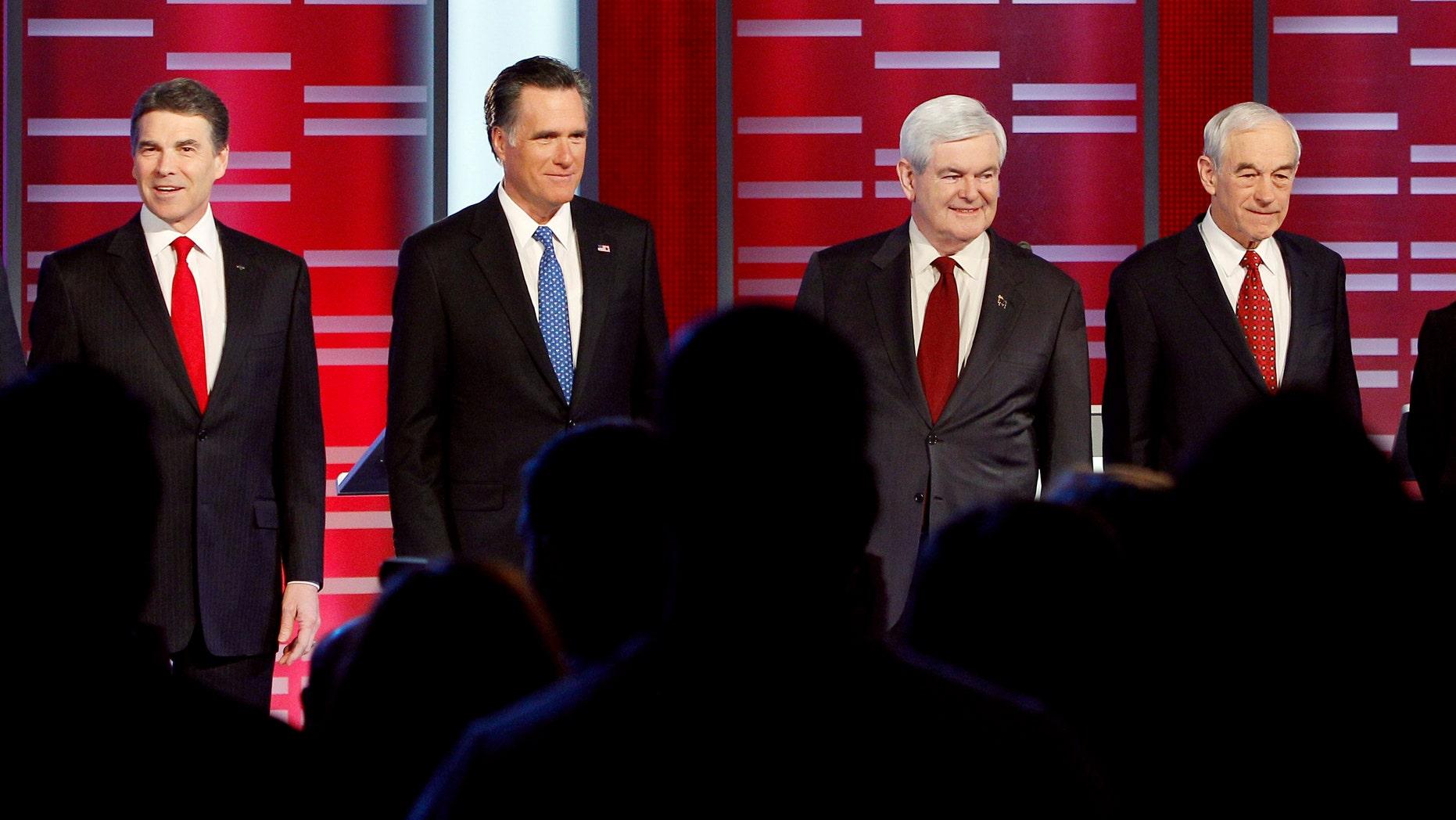 Former Pennsylvania Sen. Rick Santorum, Texas Gov. Rick Perry, former Massachusetts Gov. Mitt Romney, former Speaker of the House Newt Gingrich, Rep. Ron Paul, R-Texas, and Rep. Michele Bachmann, R-Minn, prior to their Republican debate, Saturday, Dec. 10, 2011, in Des Moines, Iowa.