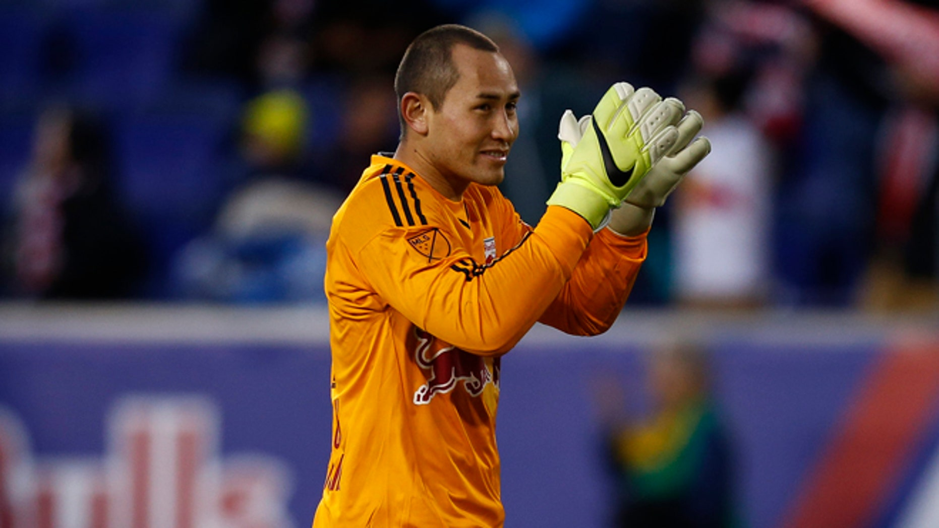 HARRISON, NJ - MARCH 22:  Luis Robles #31 of New York Red Bulls cheers the crowd after a victory over D.C. United at Red Bull Arena on March 22, 2015 in Harrison, New Jersey.  (Photo by Jeff Zelevansky/Getty Images)