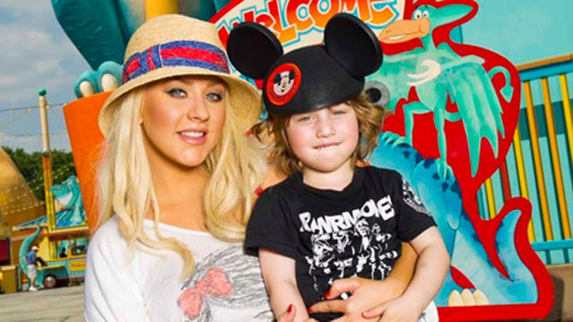 April 11, 2011: SInger Christina Aguilera poses with her son Max at Disney's Animal Kingdom theme park at Walt Disney World Resort in Lake Buena Vista, Fla.