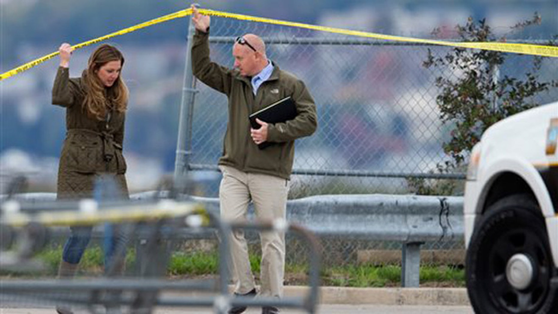 Luzerne County District Attorney Stefanie Salavantis, left, and investigator visit shooting scene outside a Walmart in Wilkes-Barre, Pa., Saturday.