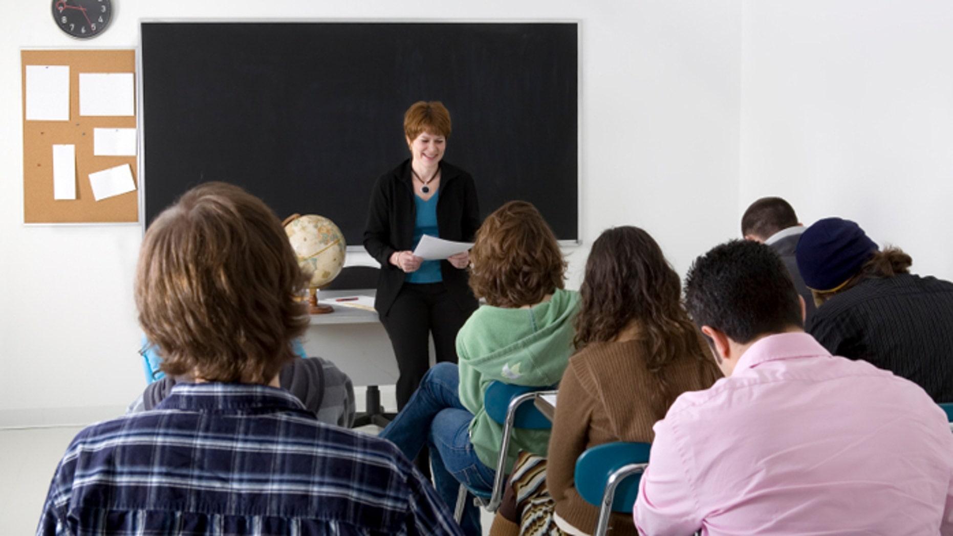 A teacher conducting a high school class.