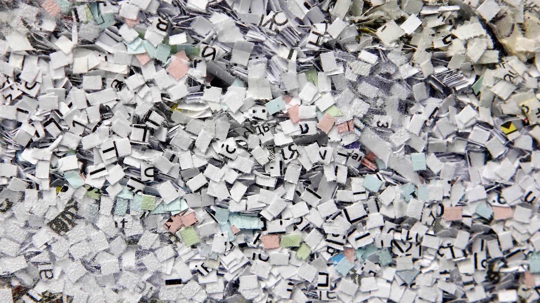 Shredded documents are seen in an office shredder in Kiev March 28, 2012.  REUTERS/Gleb Garanich (UKRAINE  - Tags: SOCIETY) - RTR300TU