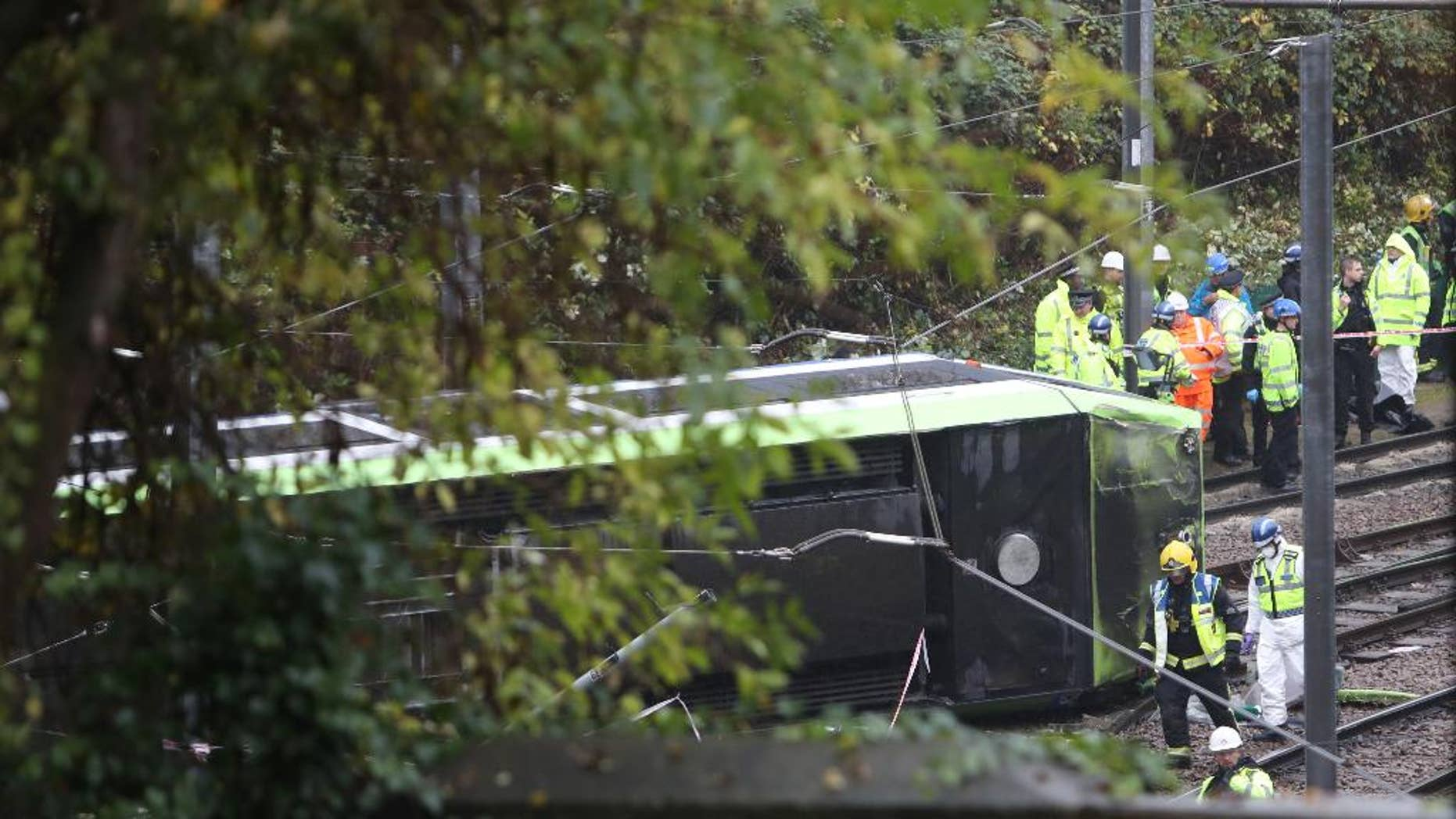 FILE - In this Nov. 9, 2016 file photo, the scene after a tram overturned in Croydon, south London. Investigators have determined that a London tram that crashed last week, killing seven people, was traveling at nearly four times the speed limit when it derailed. (Steve Parsons/PA, AP, File)