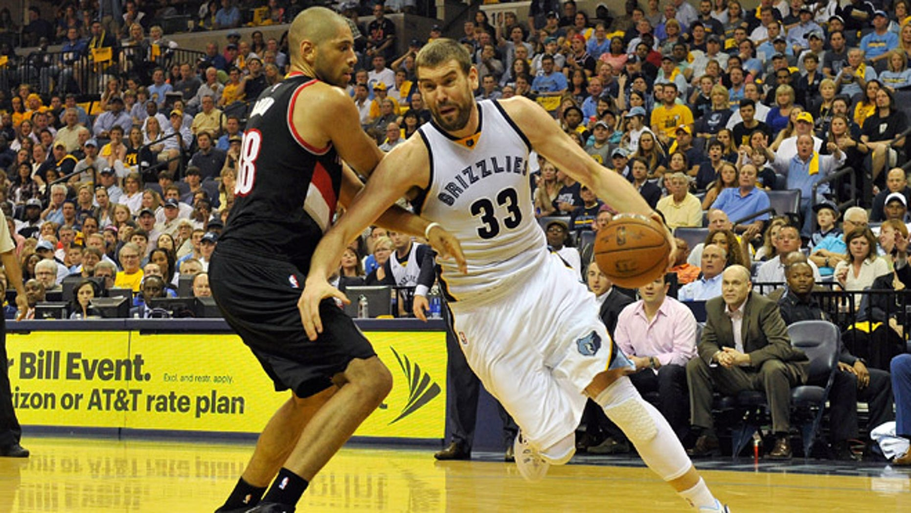 MEMPHIS, TN - APRIL 19:  Marc Gasol #33 of the Memphis Grizzlies drives past Nicolas Batum #88 of the Portland Trailblazers in the second quarter of Game One of the first round of the 2015 NBA Playoffs at FedExForum on April 19, 2015 in Memphis, Tennessee. NOTE TO USER: User expressly acknowledges and agrees that, by downloading and/or using this photograph, user is consenting to the terms and conditions of the Getty Images License Agreement.  (Photo by Frederick Breedon/Getty Images)