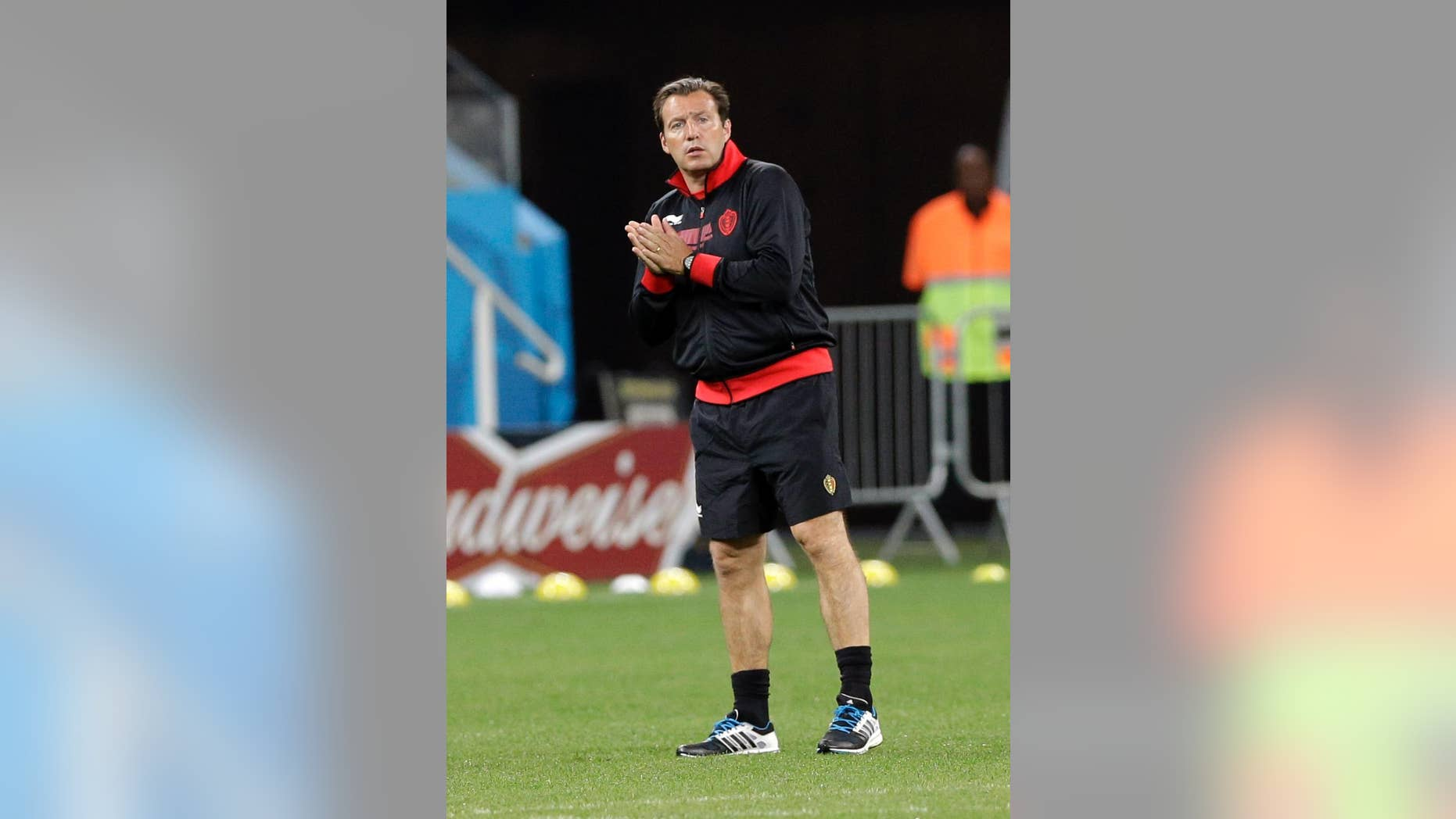 Belgium's head coach Marc Wilmots watches his players during an official training session the day before the group H World Cup soccer match between South Korea and Belgium at the Itaquerao Stadium in Sao Paulo, Brazil, Wednesday, June 25, 2014. (AP Photo/Lee Jin-man)