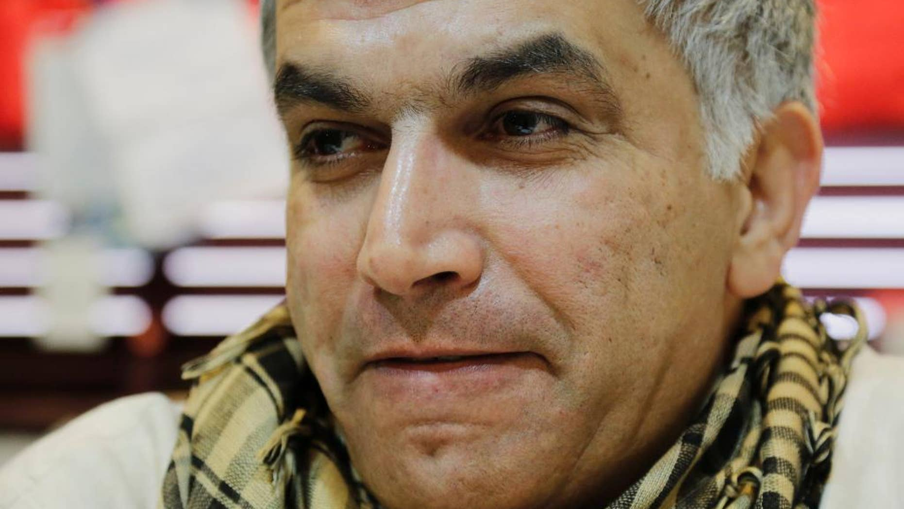 FILE - In this Tuesday, Jan. 20, 2015 file photo, Nabeel Rajab, one of Bahrain's best-known human rights activists, talks to The Associated Press during an interview hours before his conviction in Bani Jamra, Bahrain. A lawyer for Rajab said Thursday, May 14, that an appeals court has upheld a verdict against Rajab for insulting government ministries on Twitter. (AP Photo/Hasan Jamali, File)