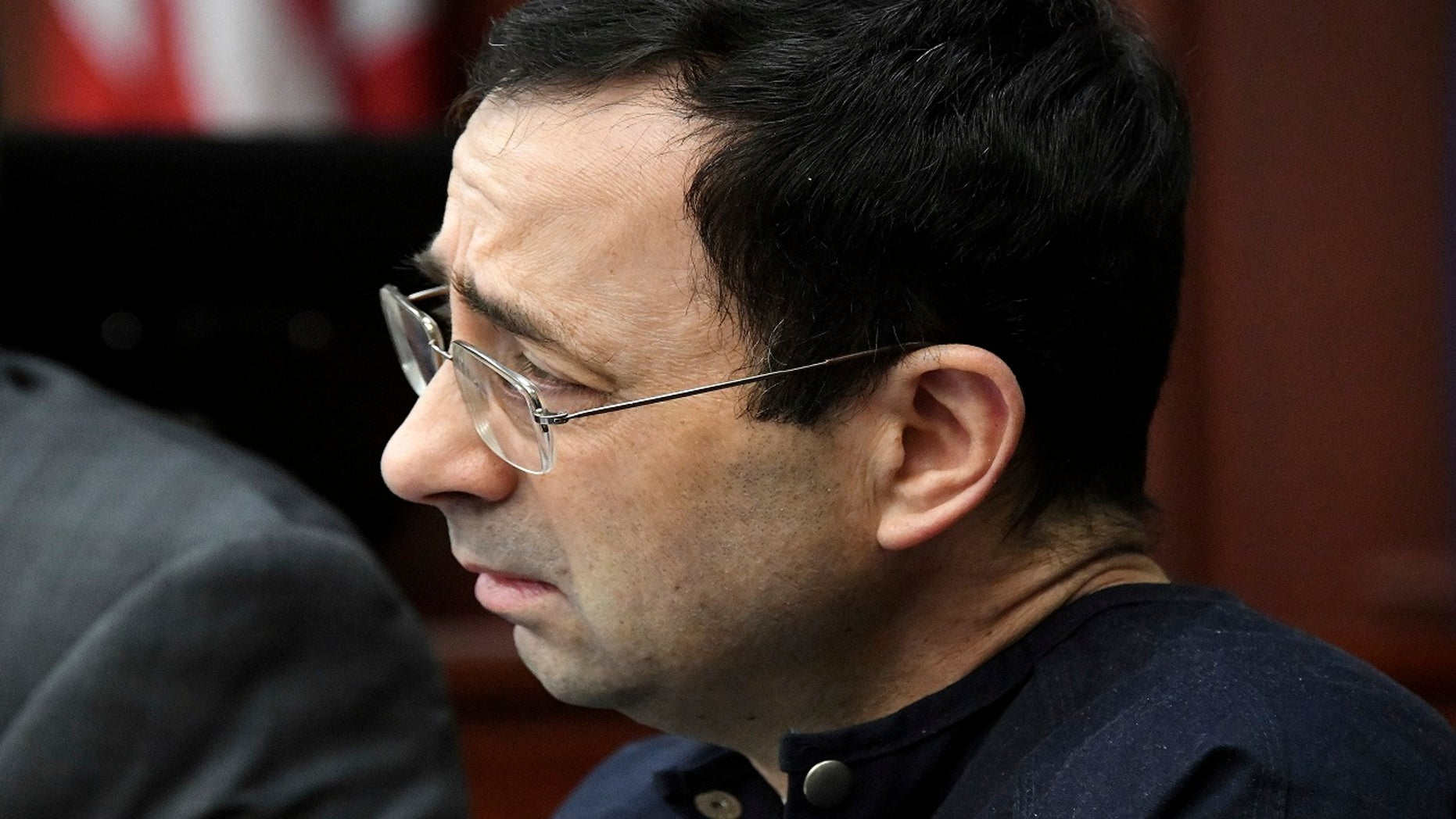 Larry Nassar listens to Jordyn Wieber's impact statement in the court of Judge Rosemarie Aquilina, Jan. 19, 2018, in Lansing, Mich., during the fourth day of sentencing for the former sports doctor, who pled guilty to multiple counts of sexual assault.