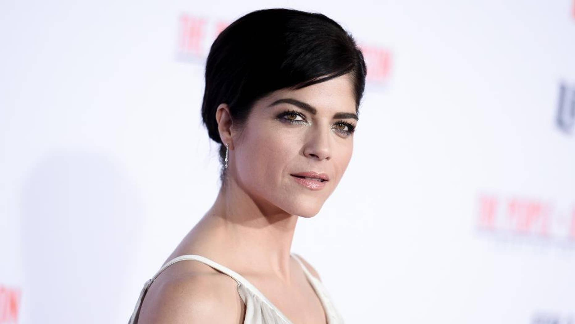 """FILE - In this Wednesday, Jan. 27, 2016 file photo, actress Selma Blair attends the LA Premiere of """"'American Crime Story: The People v. O.J. Simpson"""" at Westwood Village Theatre on in Los Angeles. Blair is apologizing for her outburst on a flight. She said in a statement to Vanity Fair on Tuesday, June 21, that she mixed alcohol with medication which caused her to black out and make statements that she regrets on a Monday flight from Cancun to Los Angeles. (Photo by Richard Shotwell/Invision/AP, File)"""