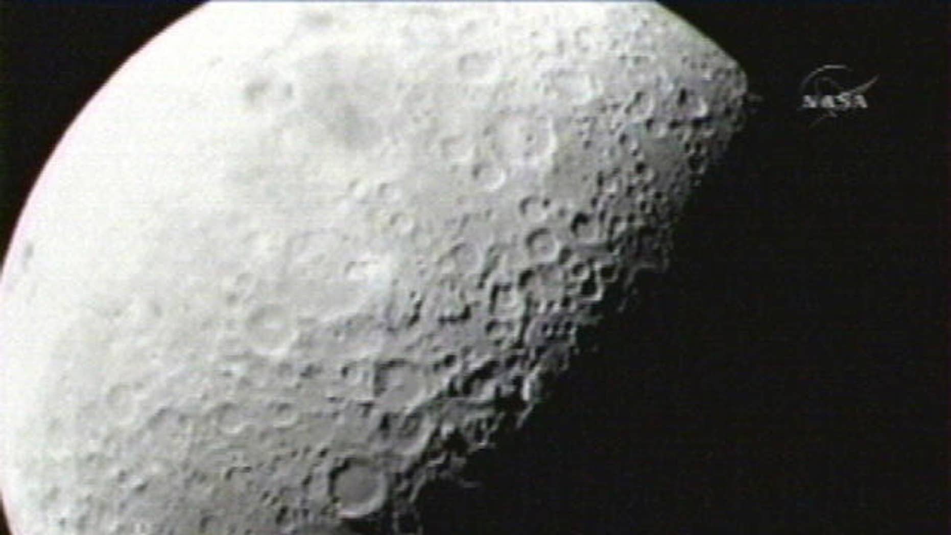 This image provided by NASA shows the first image taken of the moon from the Lunar Crater Observation and Sensing Satellite Friday morning Oct. 9, 2009. Two NASA spacecraft are barreling toward the moon at twice the speed of a bullet, about to crash into a lunar crater in a search for ice. (AP Photo/NASA)