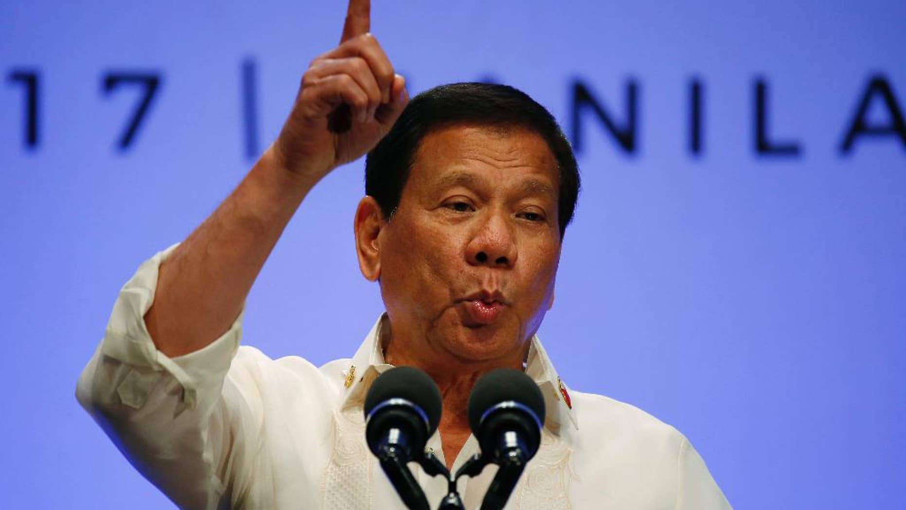 FILE - In this April 29, 2017 file photo, Philippines President Rodrigo Duterte gestures while addressing the media following the conclusion of the 30th ASEAN Leaders' Summit in Manila, Philippines. Philippine lawmakers have killed an impeachment complaint accusing President Rodrigo Duterte of crimes against humanity for the thousands of people who have died in his anti-drug crackdown. The Justice Committee of the House of Representatives, which is dominated by Duterte allies, declared Monday, May 15 during the first hearing on the matter that there was insufficient substance to proceed. (AP Photo/Bullit Marquez, File)