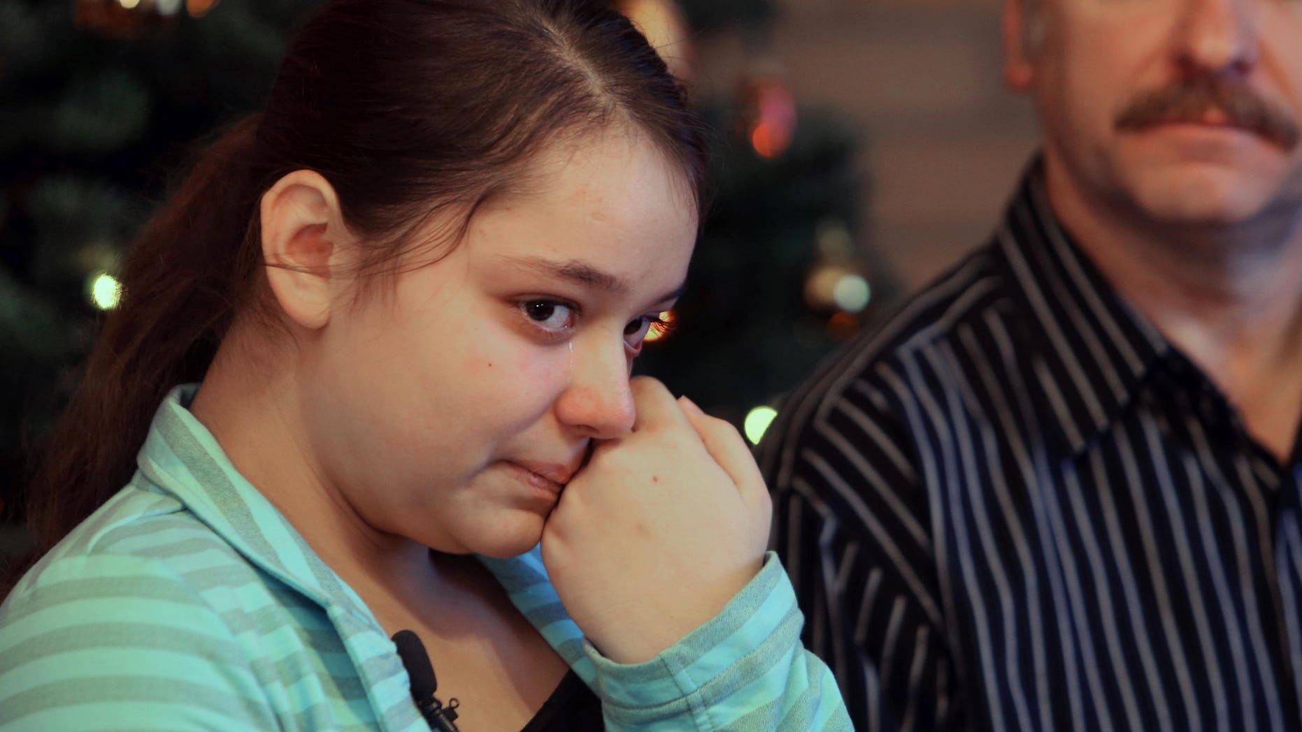 Dec. 22, 2012: Kristina Shevchenko, Clackamas Town Center shooting victim, talks to reporters for first time at her house as her father Veniamin looks on.