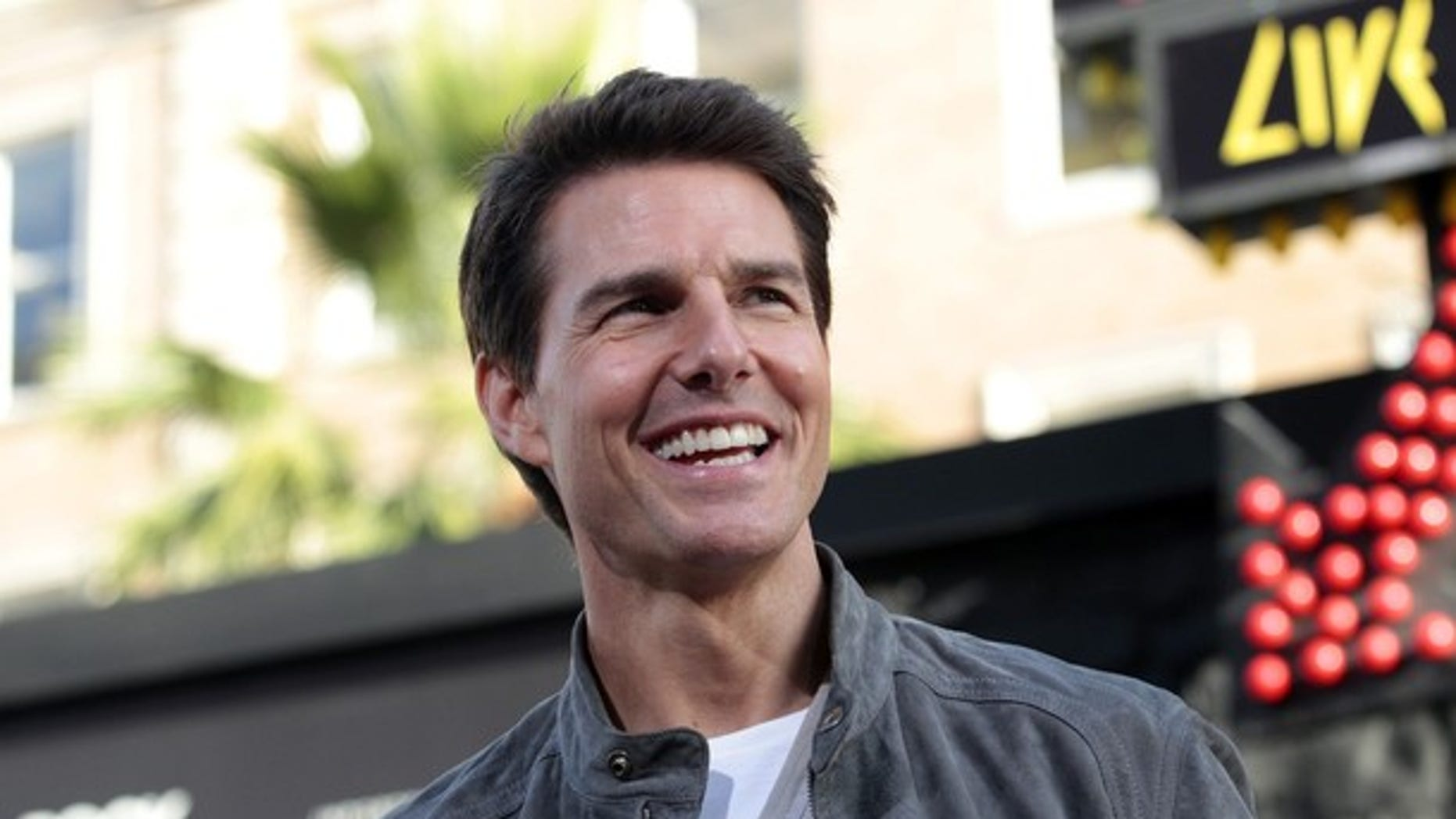 """Cast member Tom Cruise poses at the premiere of """"Rock of Ages"""" at the Grauman's Chinese theatre in Hollywood, California June 8, 2012. The movie opens in the U.S. on June 15.   REUTERS/Mario Anzuoni  (UNITED STATES - Tags: ENTERTAINMENT)"""