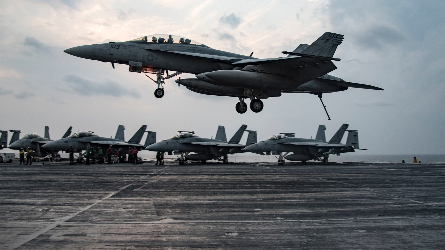 File photo - An F/A-18 F Super Hornet assigned to the Fighting Swordsmen of Strike Fighter Squadron (VFA) 32 prepares to make an arrested landing on the flight deck of the aircraft carrier USS Dwight D. Eisenhower (CVN 69) (Ike) in the Arabian Gulf.