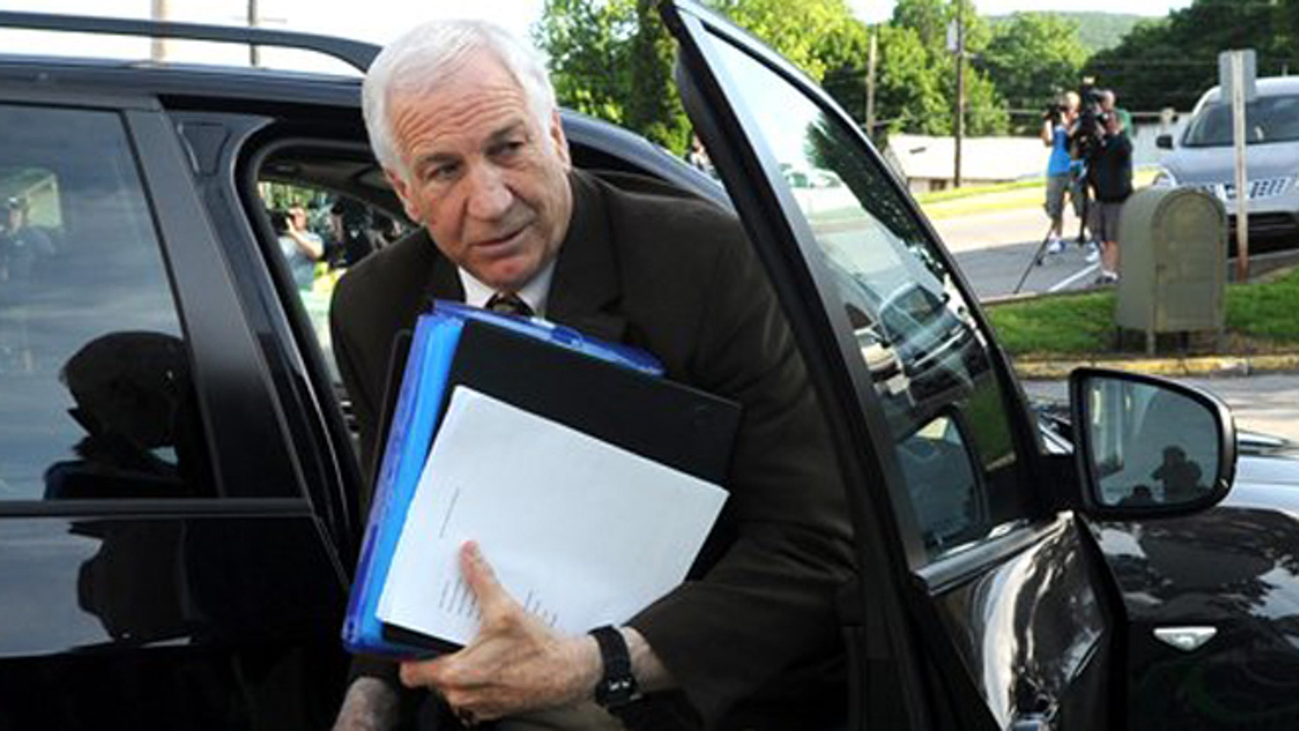 June 14, 2012: Former Penn State University assistant football coach Jerry Sandusky arrives for the fourth day of his trial at the Centre County Courthouse in Bellefonte, Pa.