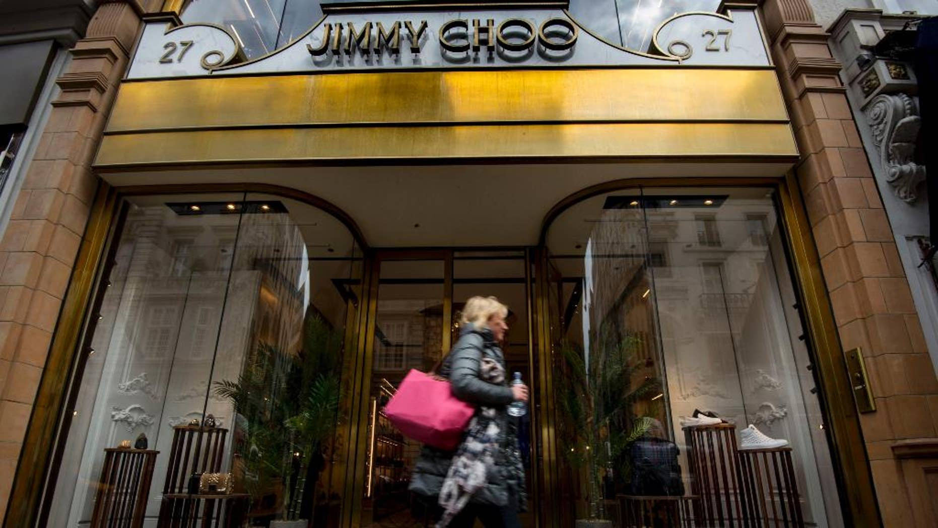 """A general view of the Jimmy Choo shop on New Bond Street, London, Monday, April 24, 2017. Shares in Jimmy Choo have leapt 11 percent after its board put the luxury shoe brand up for sale. The gains bring the market value of the firm that began in east London to over 700 million pounds ($896 million). The firm, which counts Jennifer Lopez, the Duchess of Cambridge and Beyonce among its fans, is being sold to """"maximize value for its shareholders."""" (Lauren Hurley/PA via AP)"""
