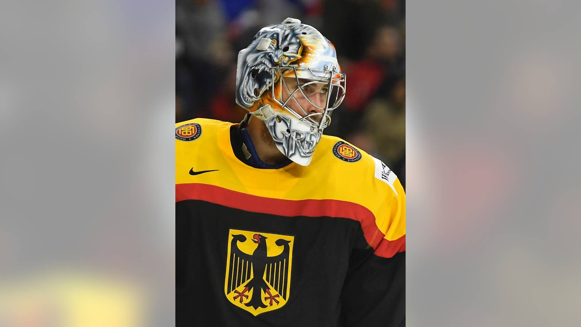 Germany's goalkeeper Thomas Greiss watches disappointed under his mask during the Ice Hockey World Championships group A match between Germany and Russia at the LANXESS arena in Cologne, Germany, Monday, May 8, 2017. (AP Photo/Martin Meissner)