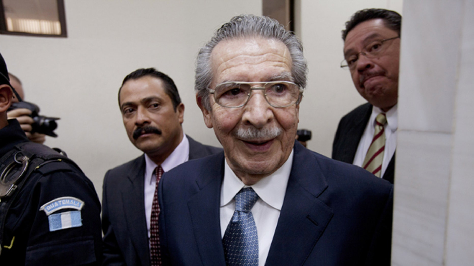 FILE - In this Jan. 24, 2013 file photo, Guatemala's former dictator Efrain Rios Montt (1982-1983) leaves the courtroom after his pre-trial hearing in Guatemala City. With his trial set to start Tuesday, March 19, 2013, prosecutors hope to painstakingly prove through a detailed recreation of the military chain of command that Rios Montt must have had knowledge of the massacres of Mayan Indians and others in the Guatemalan highlands. Because he held absolute power over the U.S.-backed military government, his failure to stop the slaughter is proof of his guilt, prosecutors and lawyers for victims say. (AP Photo/Moises Castillo, File)