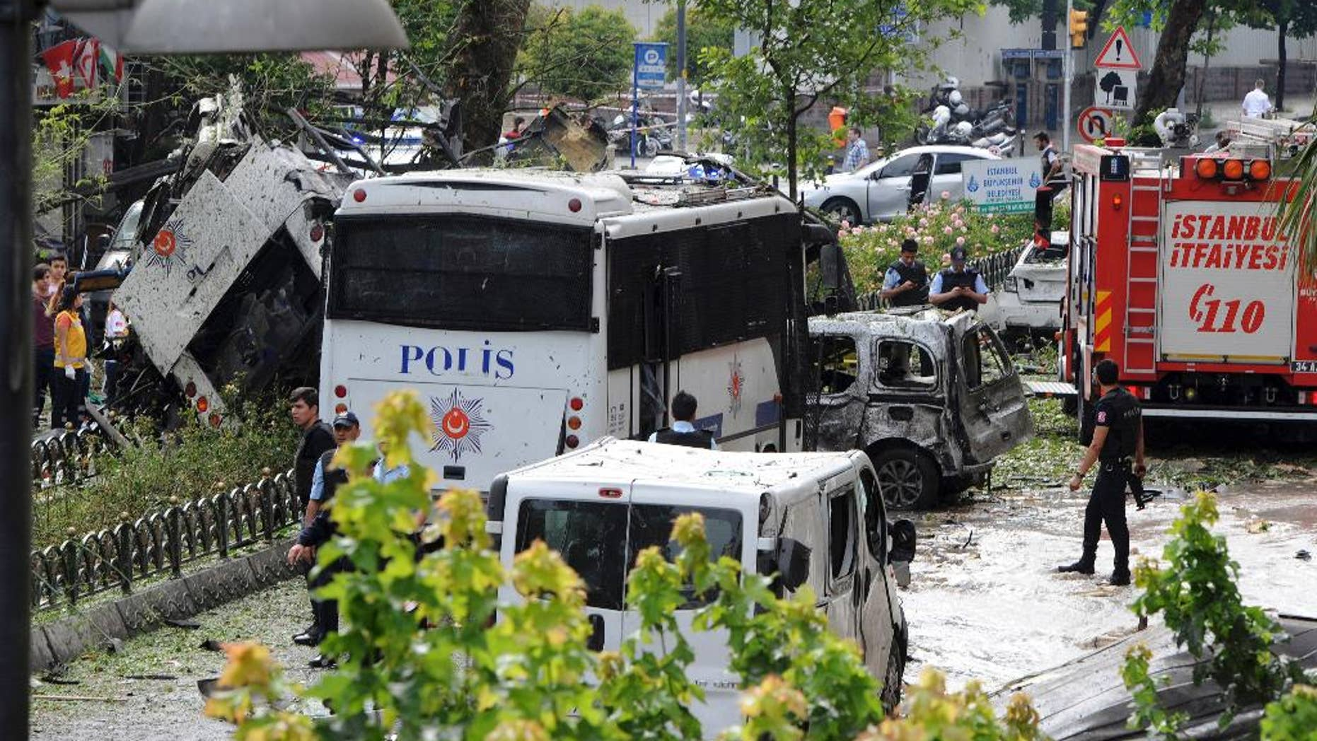 Turkish security officials and firefighters at the site of a bus explosion Tuesday.
