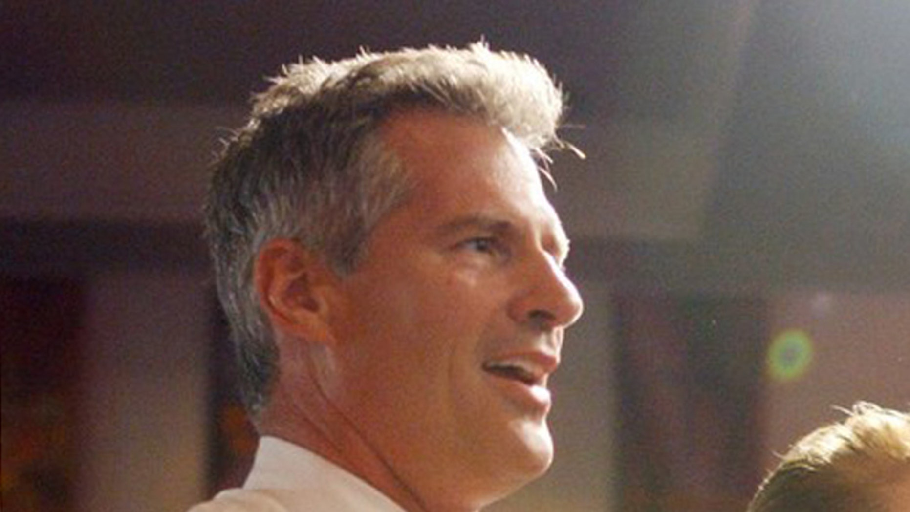 FILE: July 22, 2012: Then-Massachusetts Sen. Scott Brown, R, in the Mattapan neighborhood of Boston, Mass.