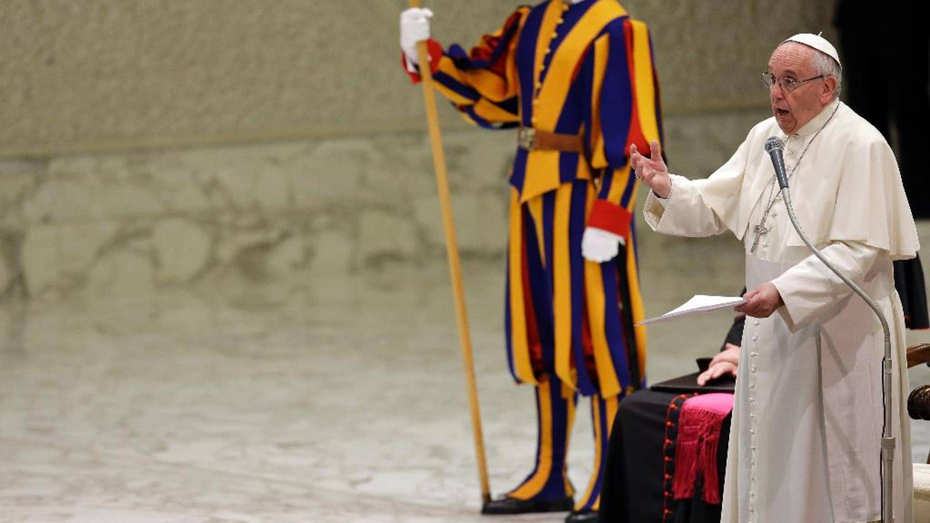 """Pope Francis delives his speech during an audience with members of the """"Policoro Group"""" a catholic association created by Italian Episcopal Conference to promote youth employment, at the Vatican, Monday, Dec. 14, 2015. (AP Photo/Gregorio Borgia)"""