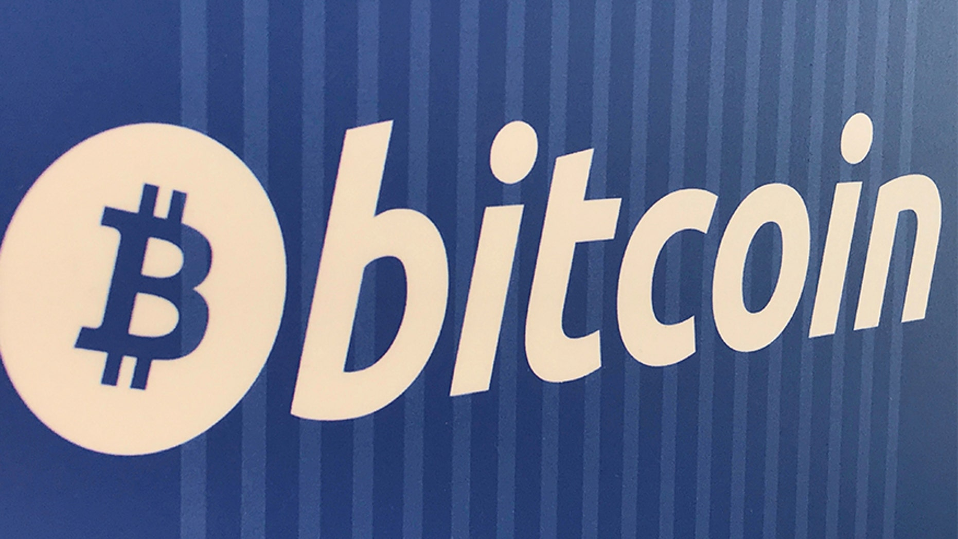 A Bitcoin trademark is seen on a cryptocurrency ATM.