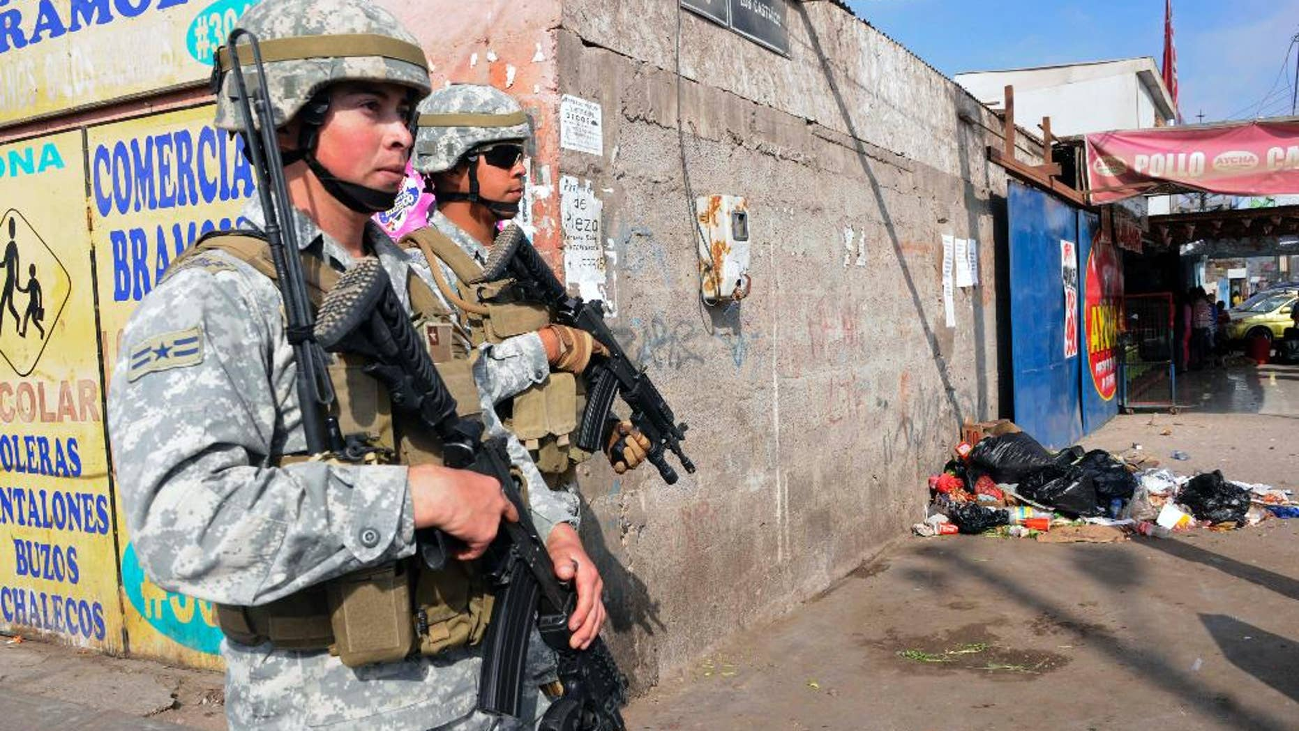 Soldiers patrol after earthquakes affected Alto Hospicio, Chile, Thursday, April 3, 2014. Chile is one of the world's most earthquake-prone countries, and tsunamis are a particular danger because the fault zone lies just offshore, where the Nazca tectonic plate plunges beneath the South American plate. A magnitude-8.2 earthquake hit Chile's Pacific coast late Tuesday. (AP Photo/Cristian Vivero)