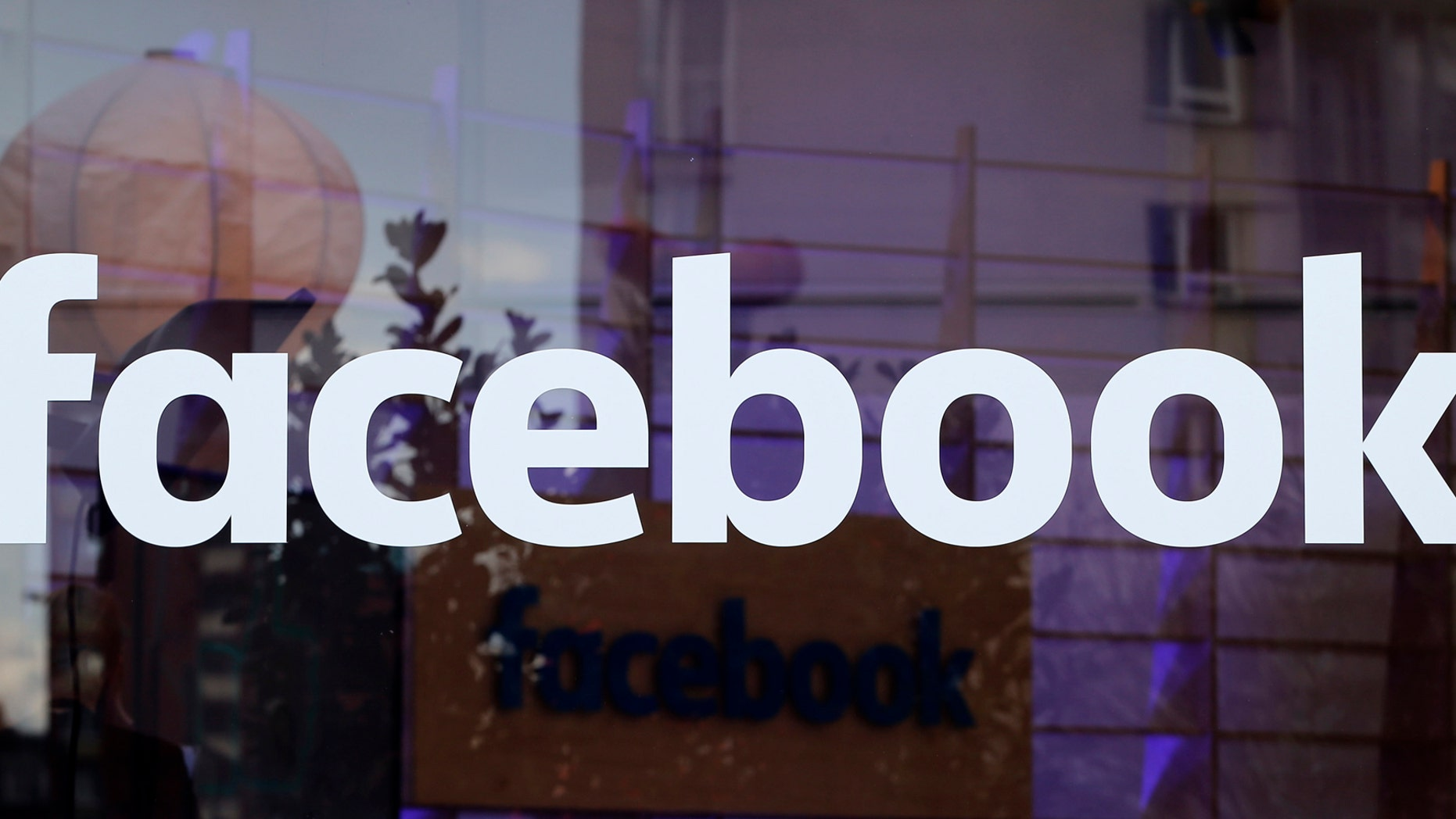 File photo: The logo of Facebook is pictured on a window at new Facebook Innovation Hub during a media tour in Berlin, Germany, February 24, 2016. (REUTERS/Fabrizio Bensch)