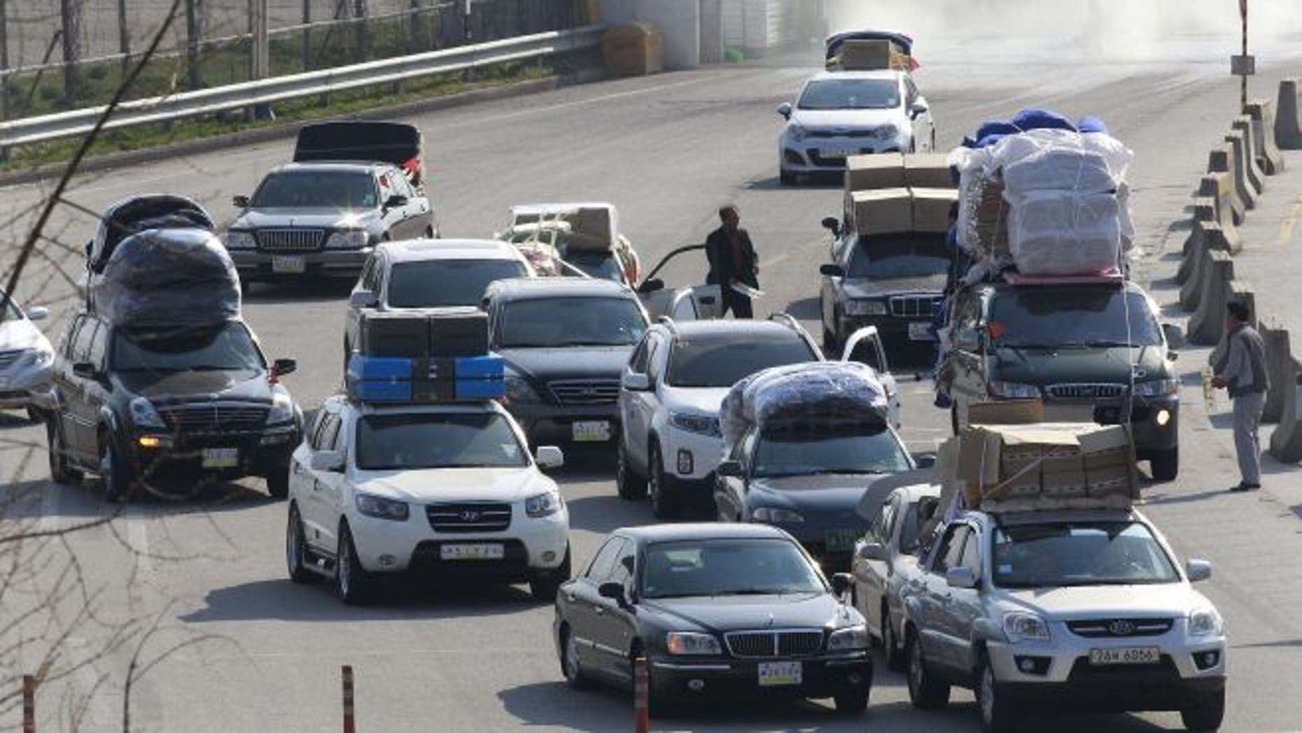 April 27, 2013: South Korean vehicles carrying products from North Korea's Kaesong industrial complex arrive at the customs, immigration and quarantine office near the border village of Panmunjom in Paju, South Korea.