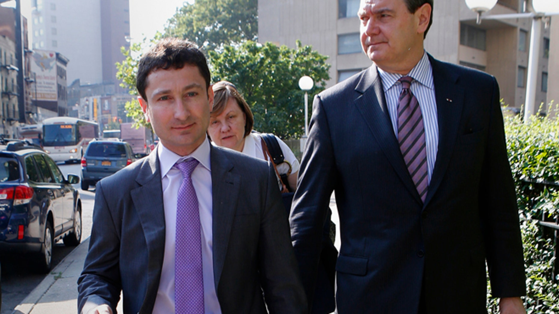 FILE 2013: Former Goldman Sachs bond trader Fabrice Tourre, left, arrives with members of his legal team at the Manhattan Federal Court in New York.